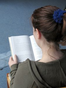 A girl reading a book.